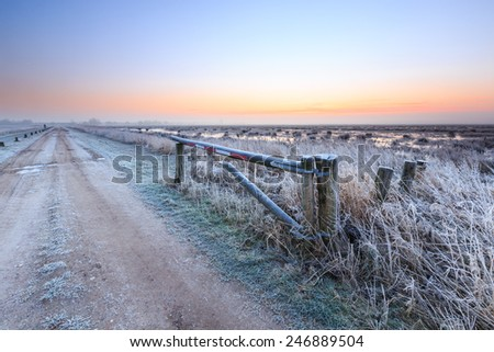 Sunrise on a cold winter day of a dutch rural landscape - stock photo