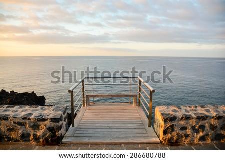 Sunrise on a Pier over Atlantic Ocean in Tenerife Canary Islands Spain - stock photo