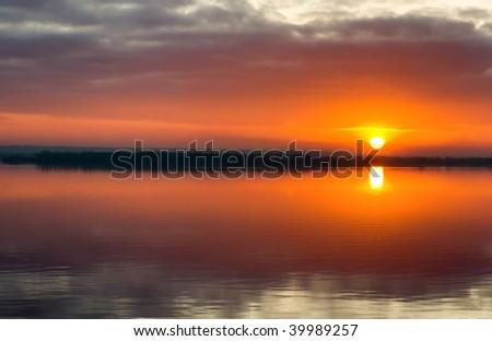 Sunrise on background of  river. north europe - stock photo