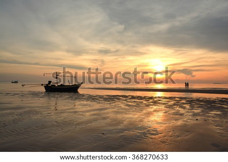 sunrise on beach with boat