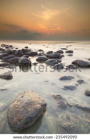 Sunrise on Black Stone Beach with calm ocean