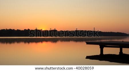 Sunrise on Large Lake - stock photo