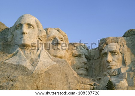 Sunrise on Presidents George Washington, Thomas Jefferson, Teddy Roosevelt and Abraham Lincoln at Mount Rushmore National Memorial, South Dakota - stock photo