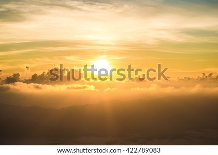 Sunrise on spectacular mountains white cloud