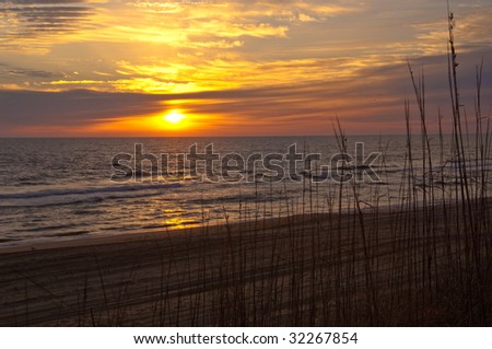 sunrise on the Atlantic ocean at Nags Head, North Carolina, USA on the outer banks national seashore - stock photo