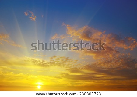 sunrise on the background of cloudy sky