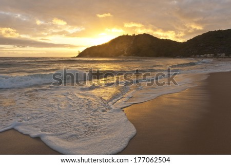 Sunrise on the beach in Mozambique - stock photo