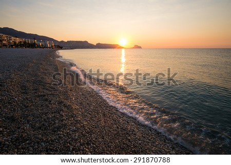 Sunrise on the calm waters of Altea bay, Costa Blanca, Spain - stock photo