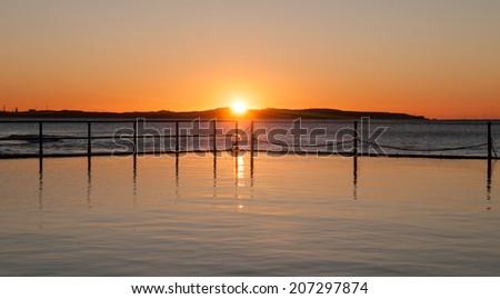 Sunrise on the Coast - stock photo