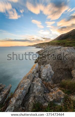 Sunrise on the coast of Islares, Cantabria, Spain - stock photo