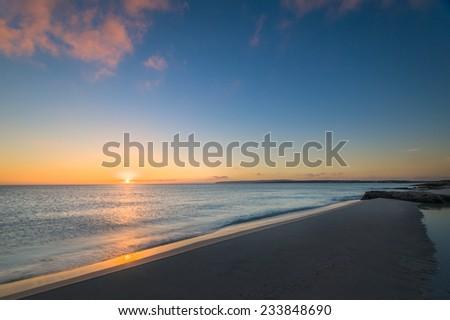 Sunrise on the famous Formentera sand beach. Balearic islands, Spain - stock photo