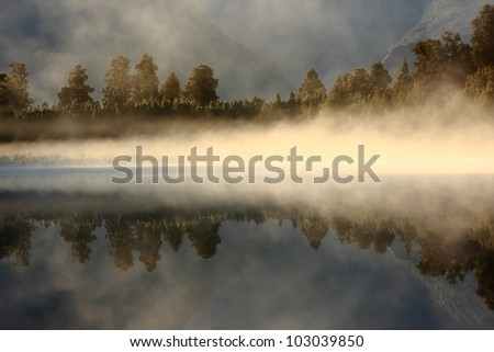 Sunrise On The Forest, Matheson Lake - stock photo