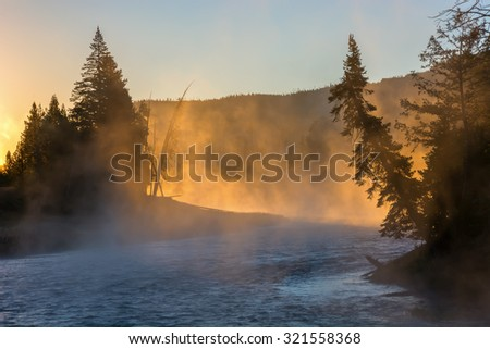 Sunrise on the Madison River in Yellowstone National Park, Wyoming. - stock photo