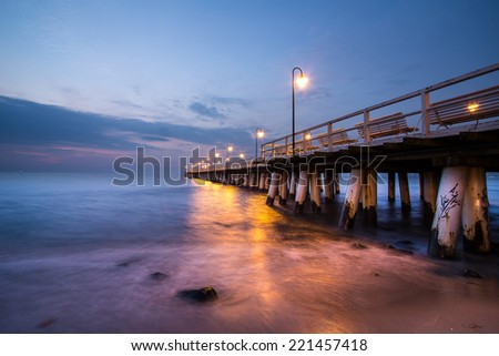 Sunrise on the pier at the seaside, Gdynia Orlowo, Poland. Autumn by the sea. hdr photo - stock photo