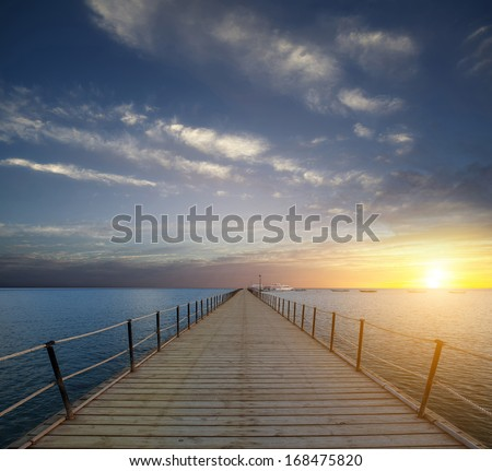sunrise on the pier dawn on a pier in the Red Sea. Africa - stock photo