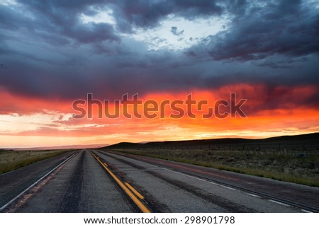 Sunrise on the road - stock photo
