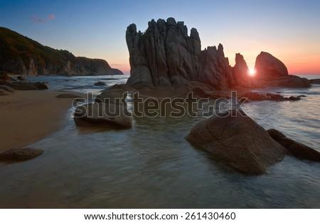 Sunrise on the rocky seashore. Far East of Russia. East (Japan) Sea. - stock photo