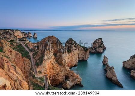 Sunrise on the sea. Seascape Lagos, Algarve. - stock photo