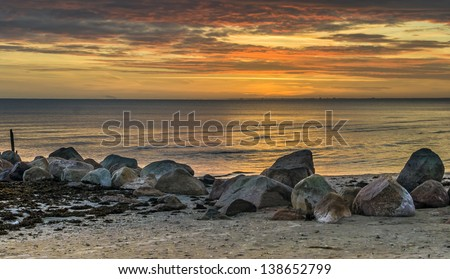 Sunrise on the stone beach of the Baltic Sea, Latvia, Europe
