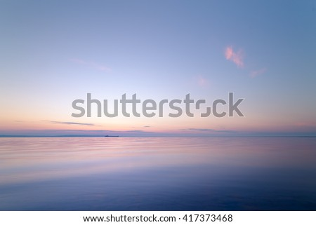 sunrise on the water / Early summer morning bright sky Beach - stock photo
