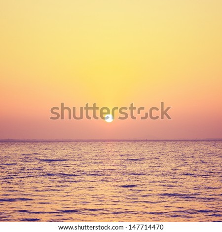 Sunrise or sunset over the sea with retro filter effect - stock photo