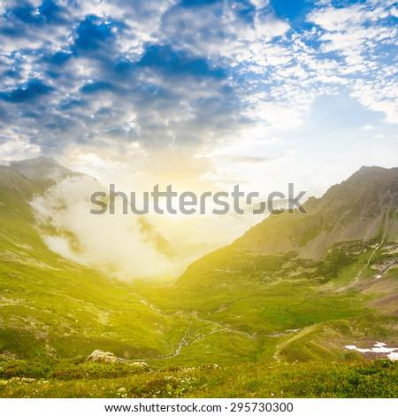 sunrise over a mountains - stock photo