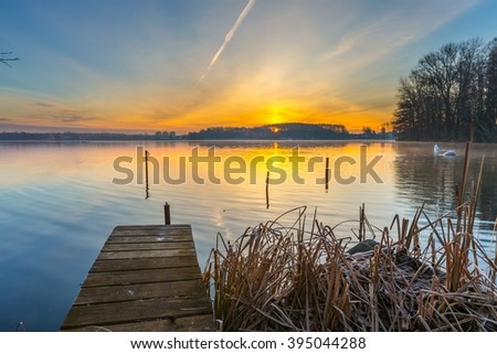 Sunrise over beautiful lake in Mazury lake district. Morning in Poland. Lake alndscape at sunrise - stock photo