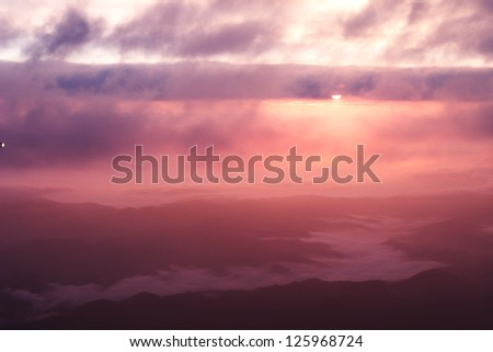 Sunrise over cloud - stock photo