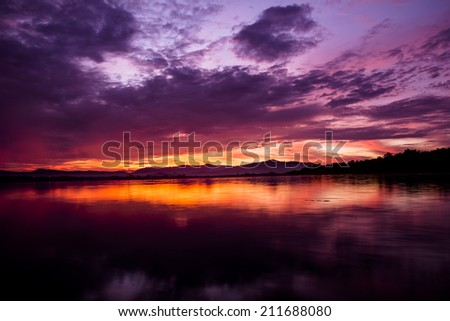 Sunrise over dam with different shades of pink and orange