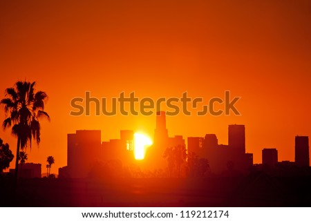Sunrise over downtown Los Angeles skyline. Still photo from timelapse sequence. - stock photo