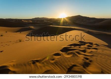 Sunrise over golden Sahara Desert in Morocco - stock photo