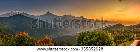 Sunrise over Himalaya mountains near Pokhara in Nepal - stock photo