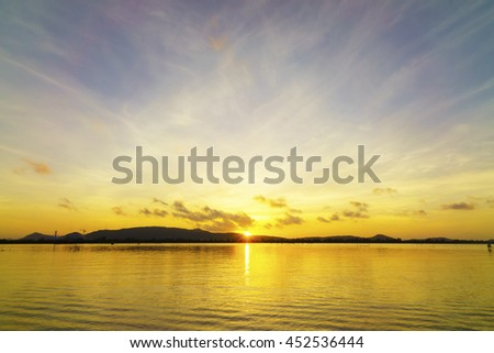 sunrise over island at lake,select focus with shallow depth of field:ideal use for background. - stock photo