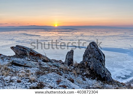 sunrise over Lake Baikal ice field, view from the mountain - stock photo