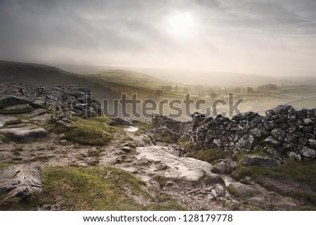 Sunrise over Malham Dale in Yorkshire Dales National Park - stock photo