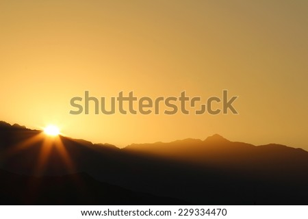 Sunrise over mountains - stock photo