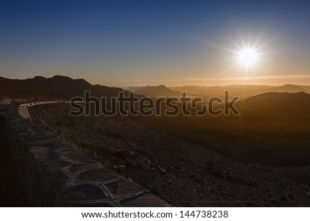 Sunrise over mountains and valley. - stock photo