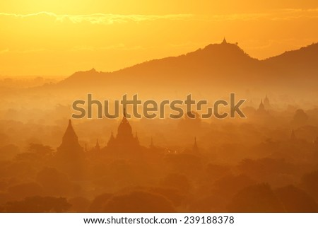 Sunrise over pagoda temples with fog of Bagan in Myanmar - stock photo
