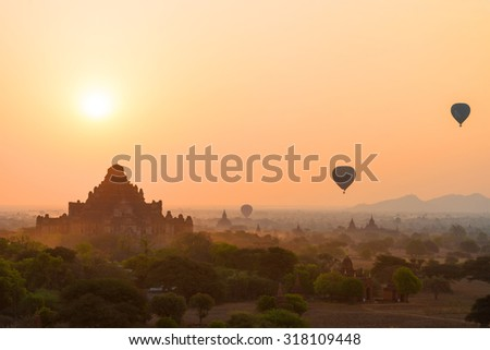 Sunrise over temples of Bagan in Myanmar, Hot air balloon over plain of Bagan in misty morning, Myanmar. Pagoda landscape in the plain of Bagan, Myanmar (Burma)