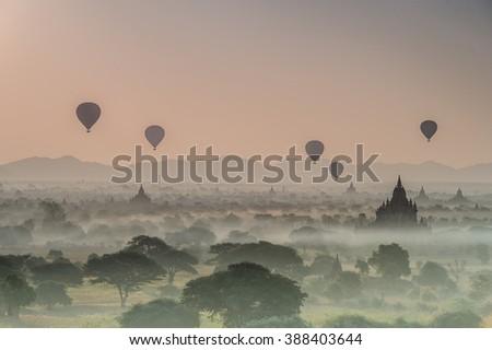 Sunrise over temples of Bagan in Myanmar, Hot air balloon over plain of Bagan in misty morning, Myanmar. Pagoda landscape in the plain of Bagan, Myanmar (Burma) - stock photo