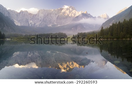 sunrise over the alpine lake Di Laghi Fusine