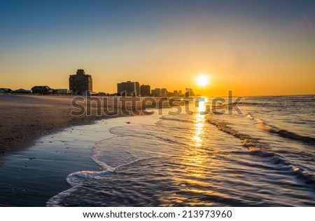 Sunrise over the Atlantic Ocean at Ventnor Beach, New Jersey. - stock photo