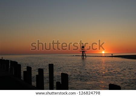 Sunrise over the Delaware Bay. - stock photo