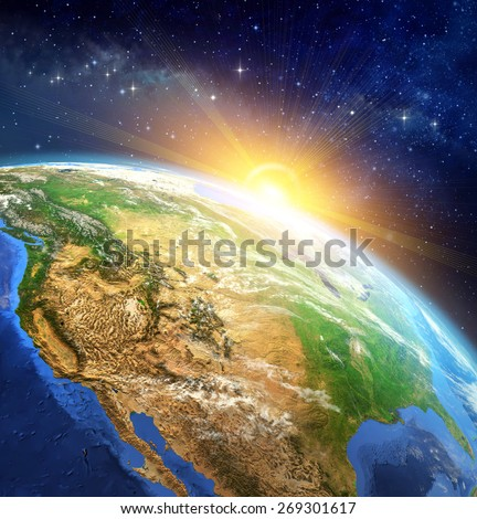 Sunrise over the Earth. Very high definition picture of planet earth in outer space with the rising sun. Elements of this image furnished by NASA