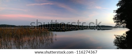 Sunrise over the lake.  Gentle colors of a dawn in the cold autumn morning
