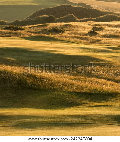 Sunrise Over the Links at St Enodoc Golf Course, Cornwall, UK. - stock photo