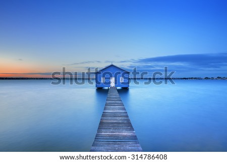 Sunrise over the Matilda Bay boathouse in the Swan River in Perth, Western Australia. - stock photo