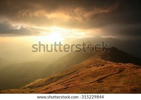 Sunrise over the mountains in the Tatras. - stock photo