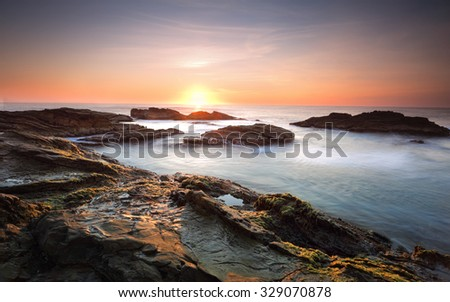 Sunrise over the ocean and the Bermagui coastline, south coast NSW, Australia - stock photo