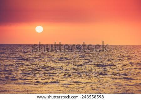 Sunrise over the ocean. Filtered image:cross processed vintage effect  - stock photo